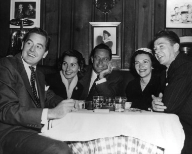 1950s The Reagan's with the Holden's and Don Taylor at Chasen's restaurant in Beverly Hills California
